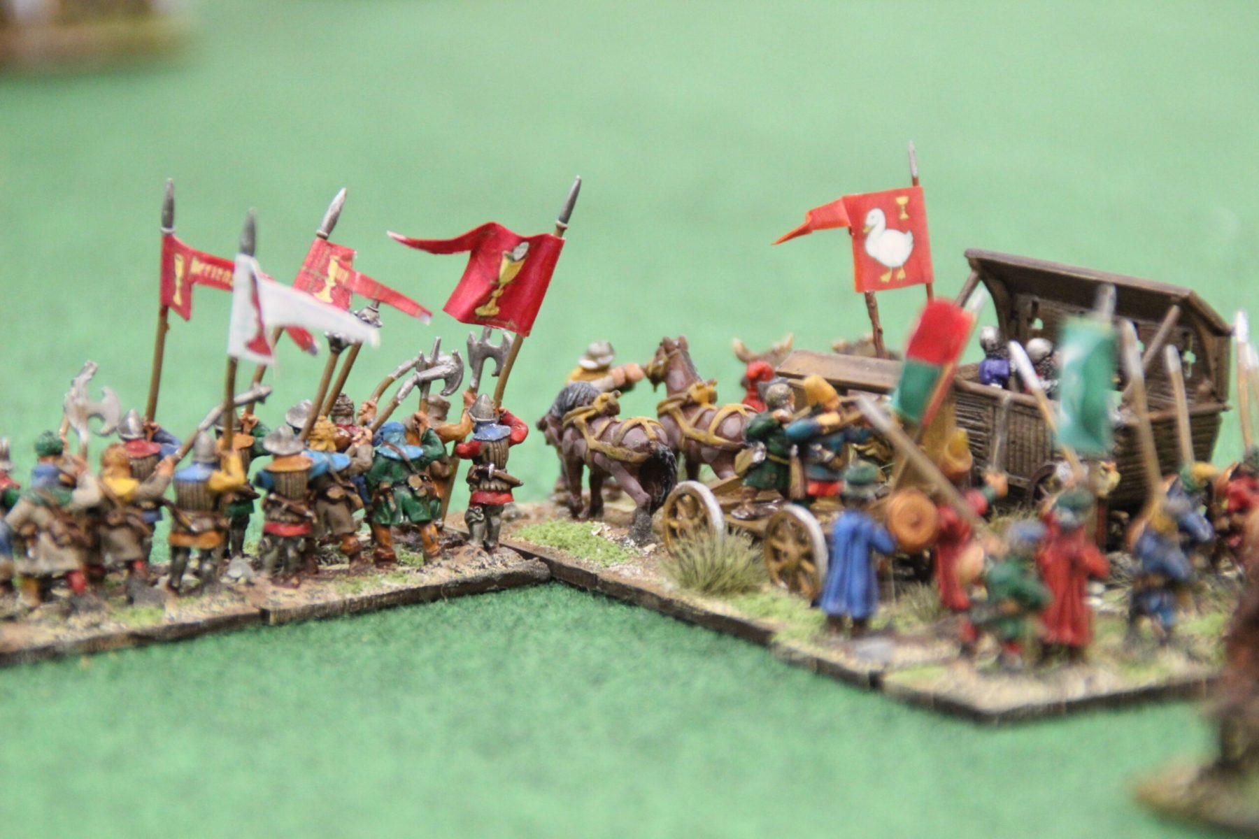 Hommes d'armes Hussites supportant un chariot de guerre.