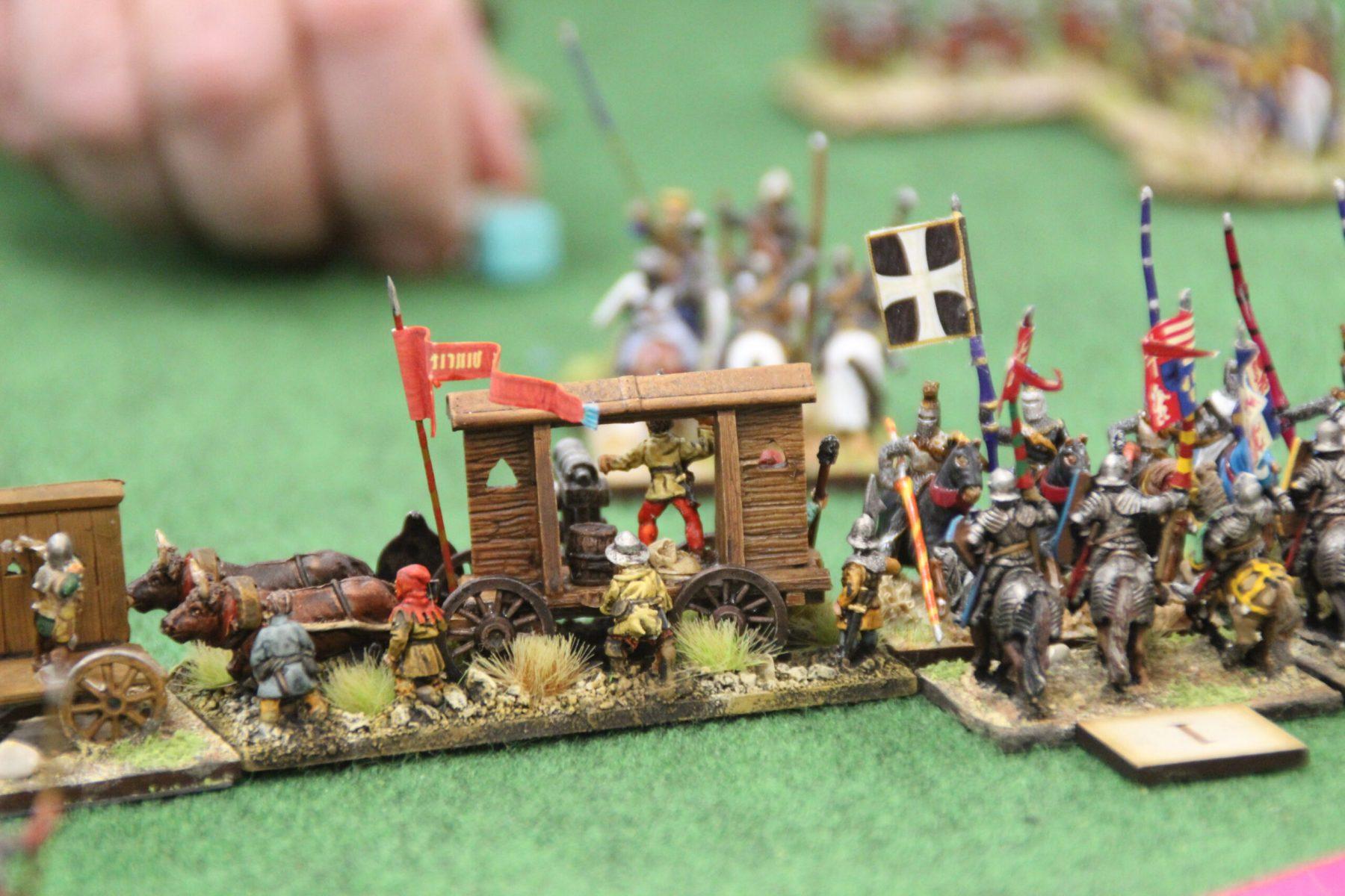 La bataille fait rage entre les Hussites et les Croisés Tardifs ! Ici, un chariot de guerre Hussite.