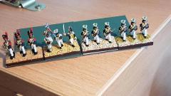 Nicolas - 4 phases de soclage sur infanterie polonaise  (application gel texturé sable jaune, brossage ocre, brossage léger crème, flocage).